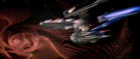 USS Enterprise caught in artificial wormhole