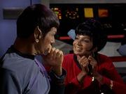 Uhura unsuccessfully chats with Spock