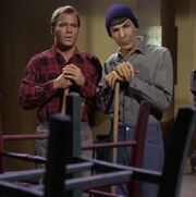 Kirk and Spock sweeping the floor