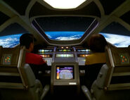 Chakotay and Torres pilot a shuttle into Earth's orbit