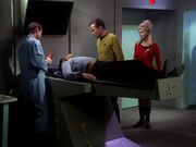 Leslie helping in sickbay