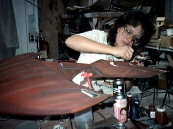 ...wearing safety glasses while applying detailing on the <i>D'Kora</i>-class studio model in 1987