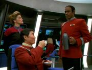 Tuvok pours Sulu tea