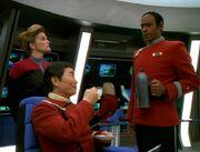 Tuvok pours Sulu tea