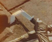 Retractable sword opening