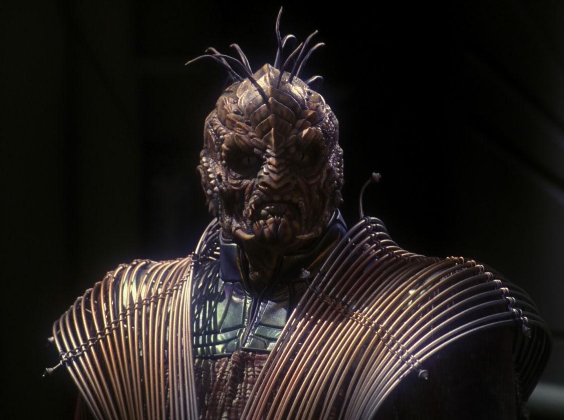 Коммандер Долим, зинди-рептилоид, 2154 год