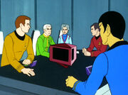 Kirk, Robert April, Sarah, April, Scott, and Spock in conference
