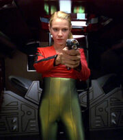 Irina holds weapon on Kim