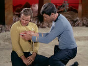 McCoy injects Kirk with neural paralyzer