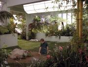 Clara Sutter planting nasturtiums