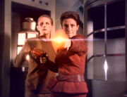 Kira and Odo fight the Hunters