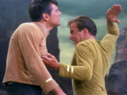 Kirk hand chops Mitchell