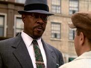 Benny Russell mit Hut und Anzug