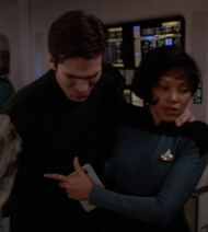 Enterprise nurse assists Ensign Fletcher