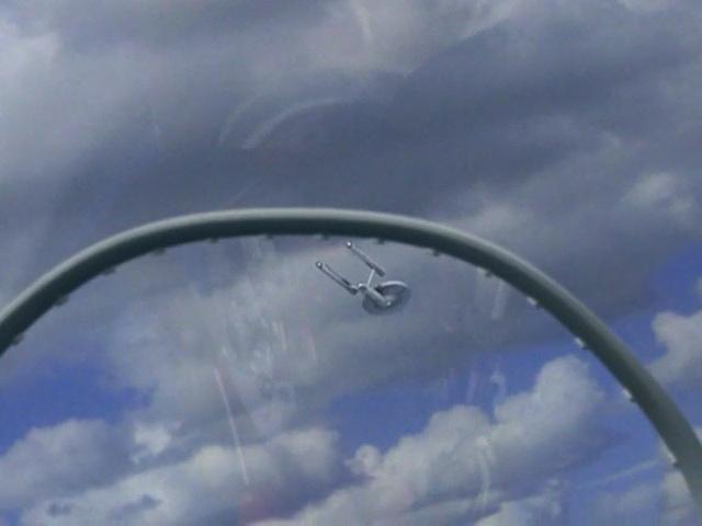 USS Enterprise in Earths sky, remastered