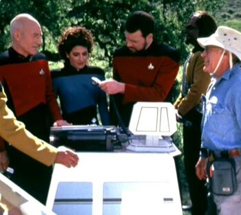 """...directing (r) the cast of <i>Star Trek: The Next Generation</i> in """"Descent"""""""