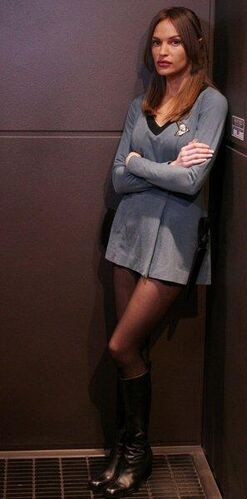 "T'Pol wearing a <a href=""/wiki/Sciences_division"" title=""Sciences division"">sciences division</a> <a href=""/wiki/Starfleet_uniform_(mid_2260s-early_2270s)"" title=""Starfleet uniform (mid 2260s-early 2270s)"" class=""mw-redirect"">uniform</a> that was found aboard the <i><a href=""/wiki/USS_Defiant_(NCC-1764)"" title=""USS Defiant (NCC-1764)"">Defiant</a></i>"