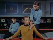 McCoy using white sound device on Kirk