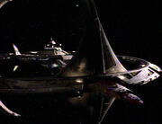 Wadi-Bajoran-Trill starship in docking bay
