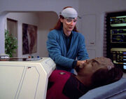 Beverly Crusher operates on Worf, 2364