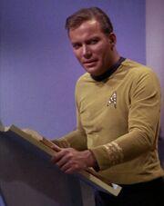 James T. Kirk with book at lectern