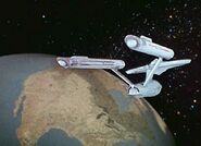 USS Enterprise orbiting Earth