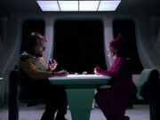 Guinan introduces Worf to prune juice
