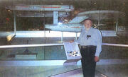 Richard C. Datin in front of the eleven foot model at the Smithsonian