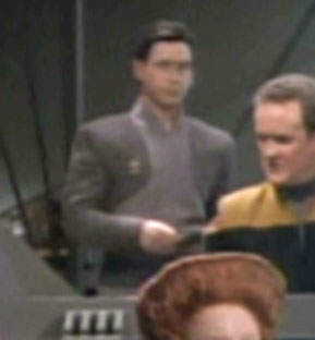 """...as a <a href=""""/wiki/Bajoran_DS9_ops_officer_005"""" title=""""Bajoran DS9 ops officer 005"""" class=""""mw-redirect"""">Bajoran officer</a>"""