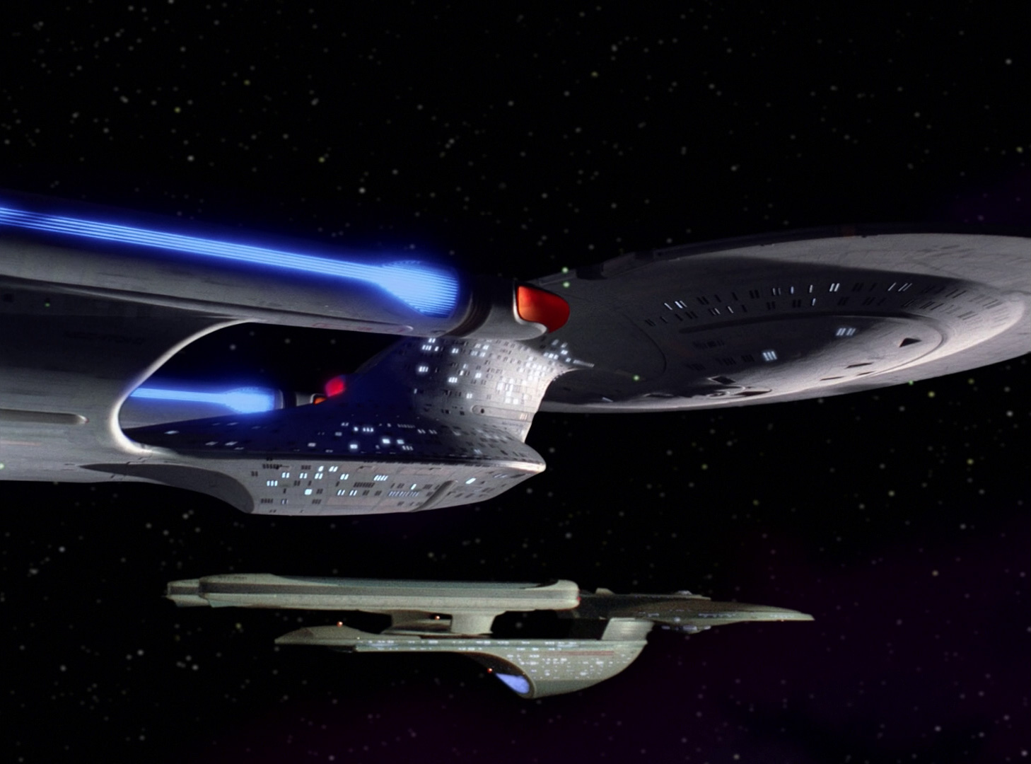 the enterprise-d parked next to an excelsior vessel