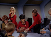 Uhura giving away tribbles