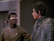 Bochra and La Forge covered in mud