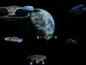 USS Voyager escorted home