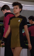 Enterprise-D crewmember with bracelet