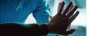 Kirk's hand on glass, Spock salutes