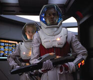 Seven and Tuvok in ev suits