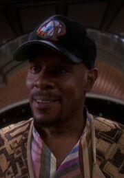Sisko wearing baseball cap