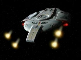 USS Defiant firing phaser cannons