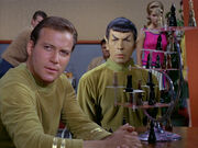 Kirk and Spock in briefing lounge playing chess