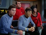 McCoy, Scotty, Spock, and Uhura watch Kirk