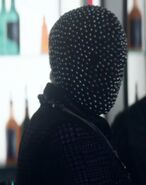 Nightbox patron with black mask