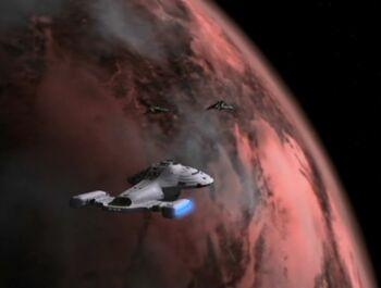 The USS Voyager in orbit of Akritiri