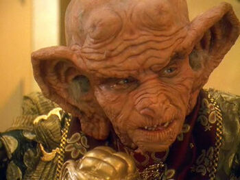"<a href=""/wiki/Grand_Nagus"" title=""Grand Nagus"">Grand Nagus</a> Gint as he appeared in <a href=""/wiki/Quark"" title=""Quark"">Quark</a>'s dream in <a href=""/wiki/2372"" title=""2372"">2372</a>"