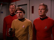 Chekov, Freeman and security guard arresting Kirk and Spock