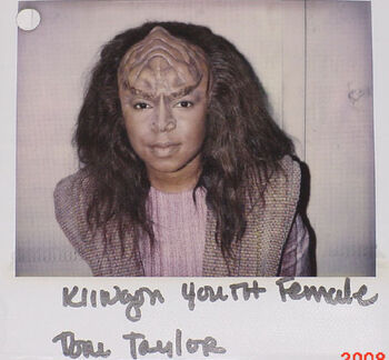 """Taylor on a makeup continuity Polaroid for """"Birthright, Part I"""""""