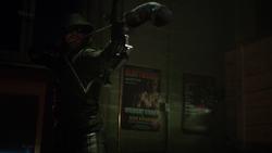 The Arrow aims a boxing glove arrow