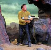 James T Kirk with phaser rifle
