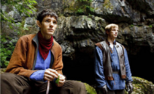 Merlin and arthur outside cave