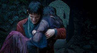 Merlin carrying Freya through the isle of the blessed