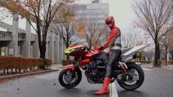 Red Buster on his bike